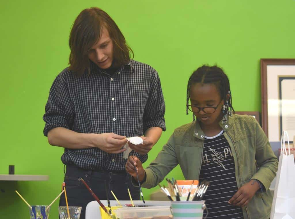 A mentor and student workign together.